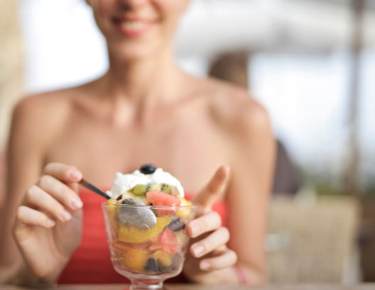 Woman eating parfait - consumable